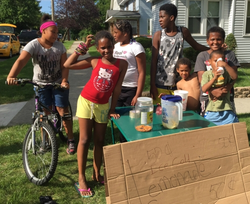 A group of kids from Strong Avenue held a lemonade sale on Aug. 2, 2016, in the wake of a triple homicide on the street. It wasn't a reaction to the incident but underscored that there's more to the neighborhood than violence. By Tim Vandenack